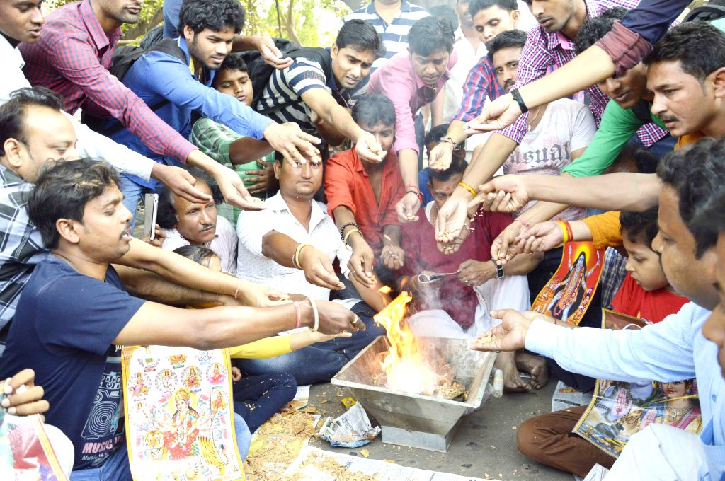 People perform yagna to pray for the people stuck in the Nepal earthquake; in Patna on April 26, 2015.