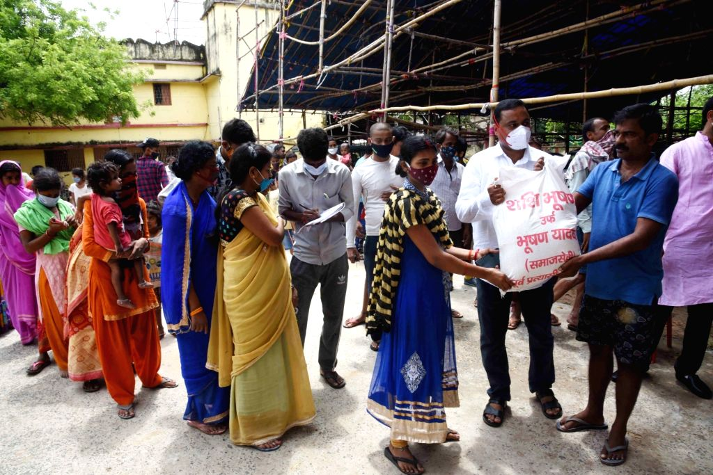 Patna : People stand in a queue to collect grocery distributed by volunteers, in Patna on Sunday, 13 June, 2021.