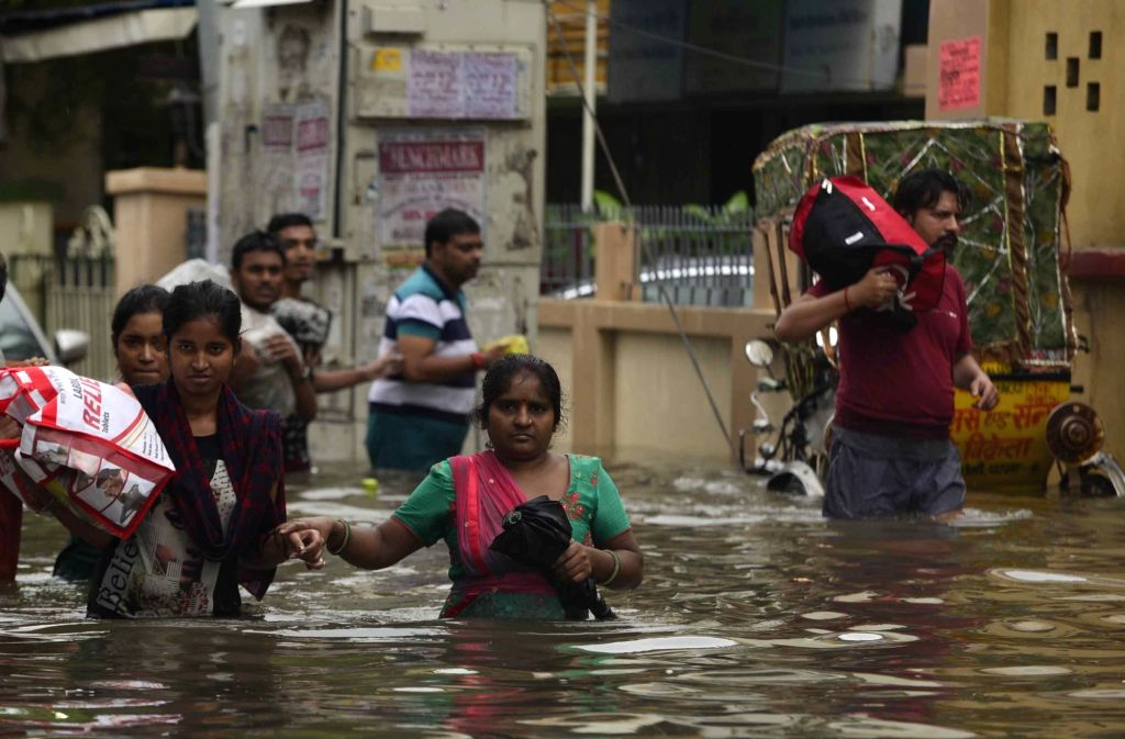 Patna: People wade through waterlogged streets, as the locality remains flooded in Patna, on 29 Sep, 2019. (Photo: IANS)