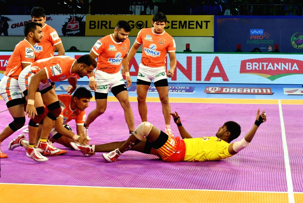 : Patna: Players in action during a Pro Kabaddi League 2018 match between Puneri Paltan and Gujarat Fortune Giants at Patliputra Sports complex in Patna on Oct 30, 2018. (Photo: IANS).