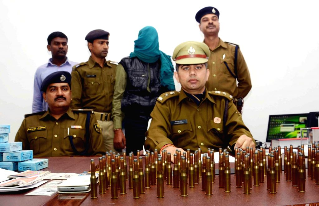 Policemen display ammunition recovered from an arms smuggler  during a press conference in Patna on Dec 4, 2014.