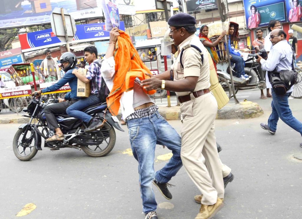 Policemen take away ABVP members trying to enforce a shutdown called to protest the police action against its members last week; on March 30, 2015.