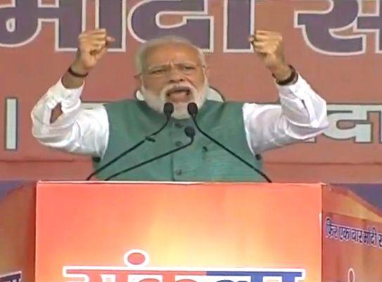 Patna: Prime Minister Narendra Modi addresses a 'Sankalp Rally' in Patna, on  March 3, 2019. (Photo: IANS/BJP) - Narendra Modi