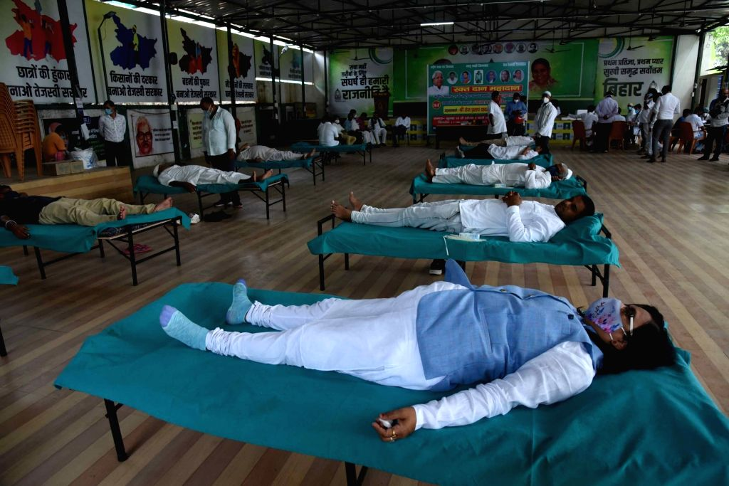 Patna :  Rashtriya Janta Dal members and supporters at the mass level blood donation camp for needy during the celebrate the 74th birthday of party supremo Lalu Prasad in Patna on Friday 11 June 2021.