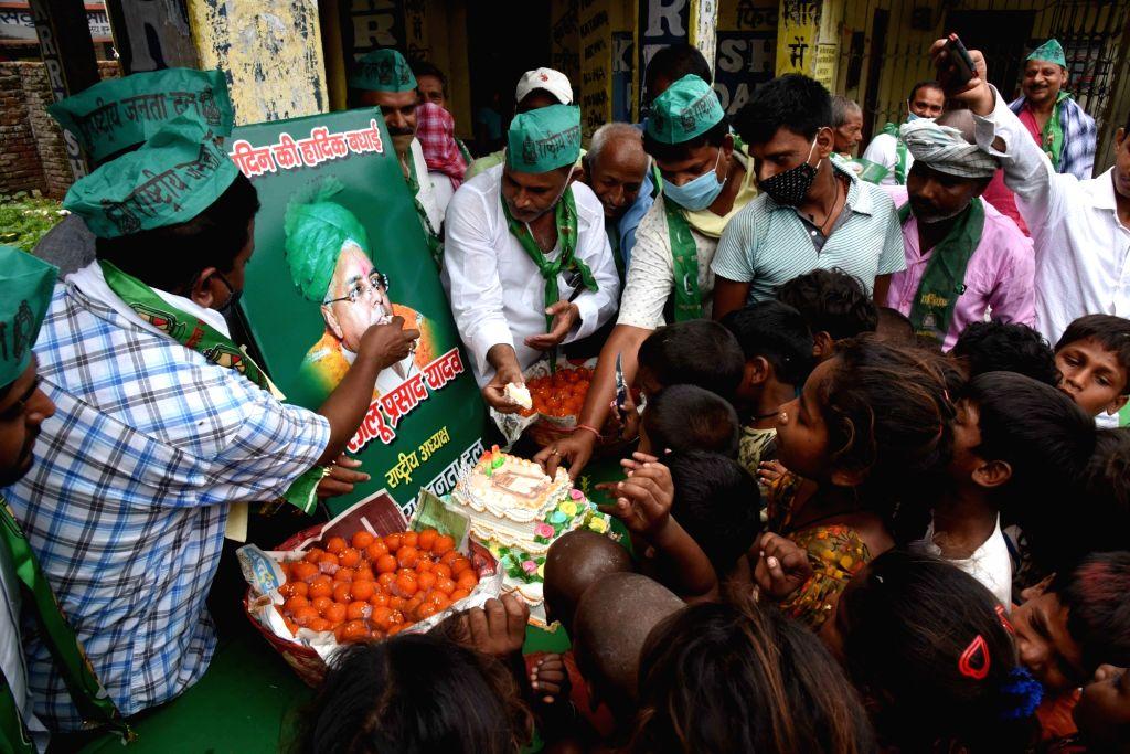 Patna :  Rashtriya Janta Dal (RJD) members and supporters celebrate the 74th birthday of party supremo Lalu Prasad  in Patna on Friday 11 June 2021.