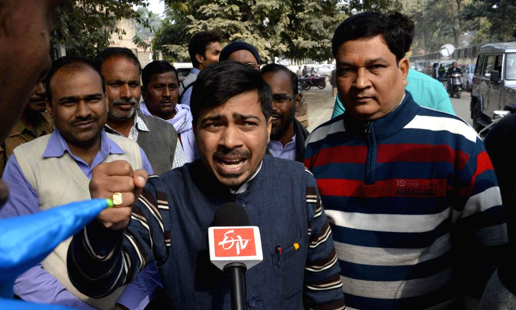 Rebel MLA of Janata Dal - United Ravindra Rai addresses press at Patna High Court in Patna, on Jan 6, 2015. The High Court reinstated membership of four rebels of the party, who were earlier .. - Uday Narayan Chaudhury and Ravindra Rai