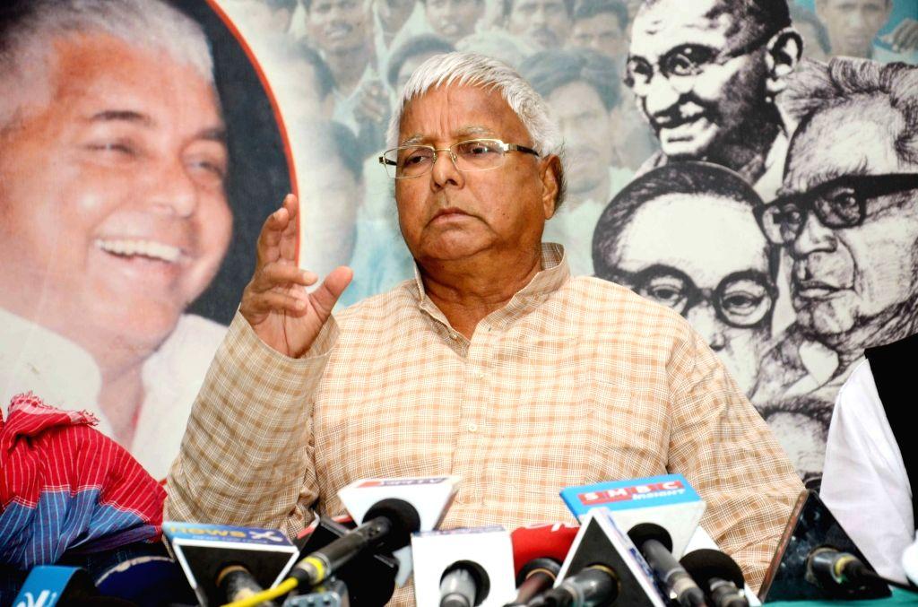 :Patna: RJD leader Lalu Prasad Yadav addresses a press conference in Patna, on Nov 5, 2015. (Photo: IANS). - Nitish Kumar
