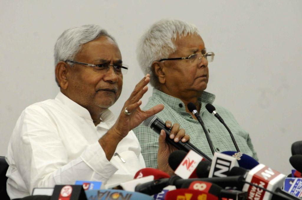 :Patna: RJD leader Lalu Prasad Yadav and JD(U) leader Nitish Kumar during a press conference in Patna on Nov 8, 2015. (Photo: IANS). - Nitish Kumar and Narendra Modi