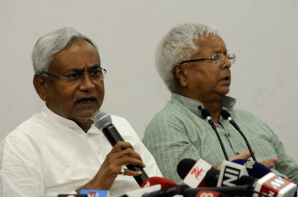 : Patna: RJD leader Lalu Prasad Yadav and JD(U) leader Nitish Kumar during a press conference in Patna on Nov 8, 2015. (Photo: IANS). - Arvind Kejriwal and Nitish Kumar