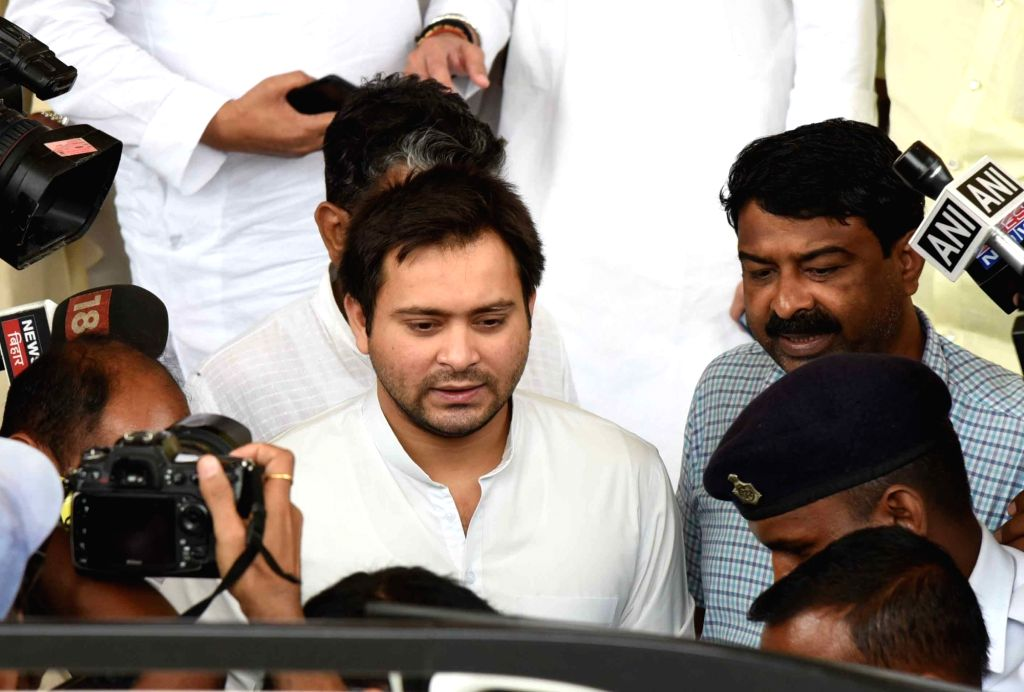 Patna: RJD leader Tejashwi Yadav arrives at Bihar Assembly after failing to attend the ongoing Monsoon Session for four consecutive days, in Patna on July 4, 2019. (Photo: IANS) - Tejashwi Yadav