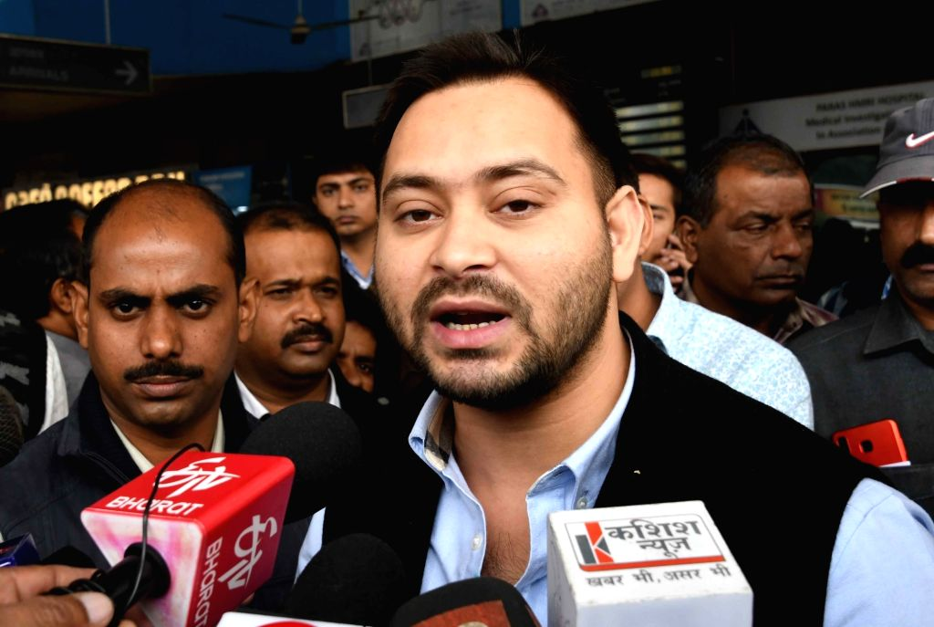 Patna: RJD leader Tejashwi Yadav talks to the media in Patna, on Dec 5, 2018. (Photo: IANS) - Tejashwi Yadav