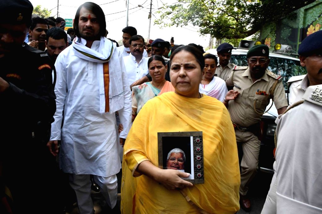 Patna: RJD's Lok Sabha candidate from Pataliputra, Misa Bharti accompanied by her mother Rabri Devi and brother Tej Pratap Yadav, arrives to file her nomination for the forthcoming Lok Sabha elections in Patna, on April 25, 2019. (Photo: IANS) - Tej Pratap Yadav
