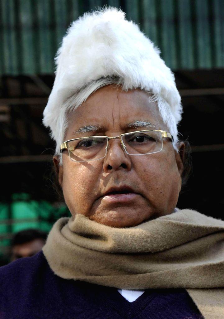 RJD supremo Lalu Yadav during Makar Sankranti feast organised at his residence in Patna, on Jan 15, 2015. - Lalu Yadav