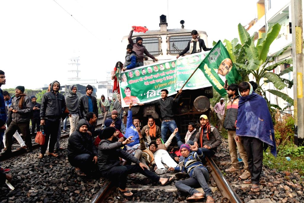 Patna: RJD workers block railway tracks and disrupt railway services during 'Rail Roko' protest against the Citizenship Amendment Act (CAA) 2019 and National Register of Citizens (NRC) during Bihar bandh called by the party, in Patna on Dec 21, 2019.
