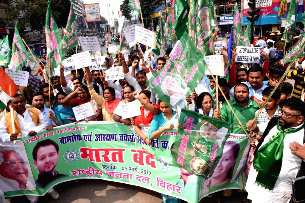 "Patna: RJD workers participate in a march during ""Bharat Bandh"" in Patna on Feb 5, 2019. (Photo: IANS)"
