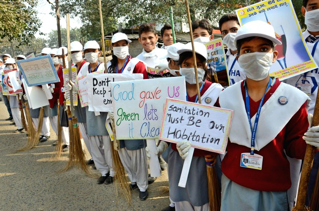 Students participate in Clean India Campaign in Patna on Nov 26, 2014.
