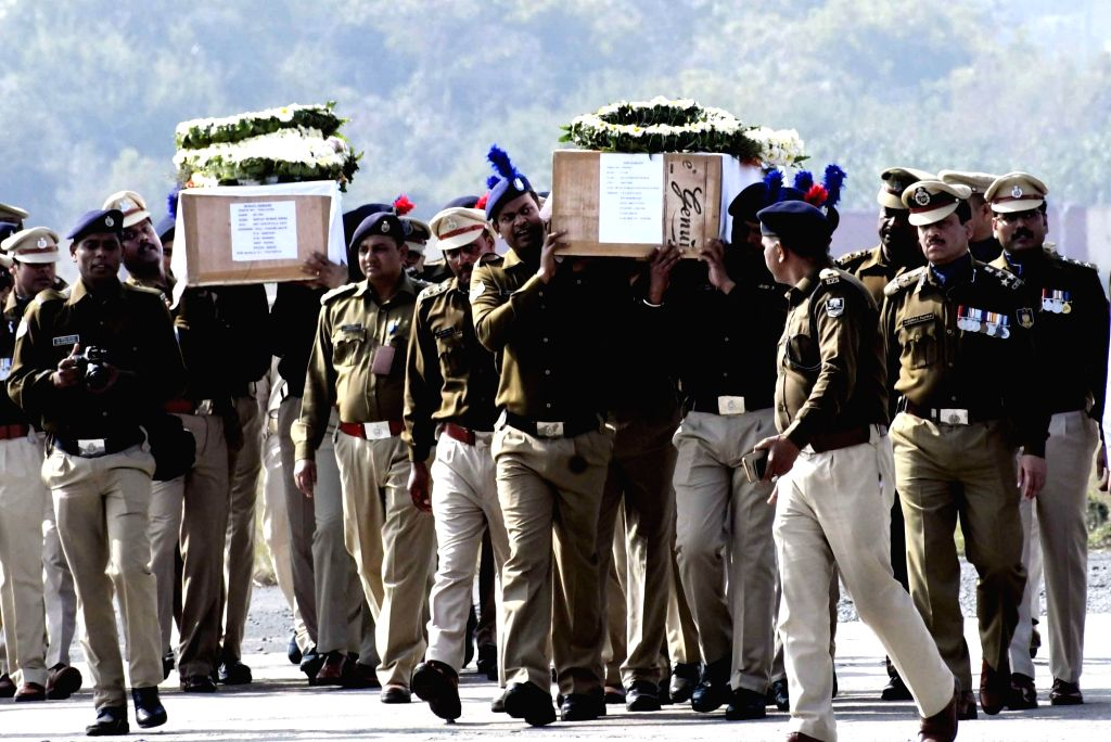 Patna:  The coffins of Ratan Kumar Thakur and Sanjay Kumar Sinha, who were among the 49 CRPF personnel killed in 14 Feb Pulwama militant attack, arrive in Patna on Feb 16, 2019. (Photo: IANS) - Kumar Thakur and Sanjay Kumar Sinha