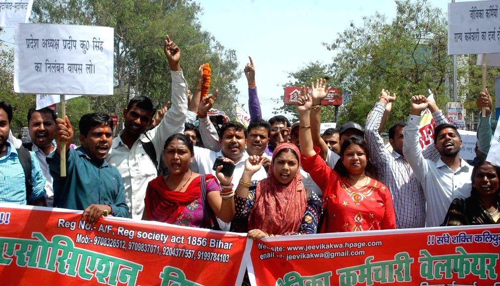 The members of Jeevika Karamchari Welfare Association stage a demonstration in Patna on April 6, 2015.
