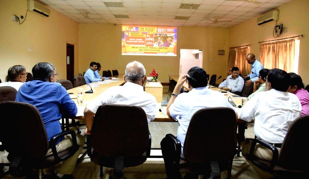 Patna: Traders watch the telecast of Union Budget 2019 presented by Union Finance Minister Nirmala Sitharaman in the Lok Sabha; in Patna on July 5, 2019. (Photo: IANS) - Nirmala Sitharaman