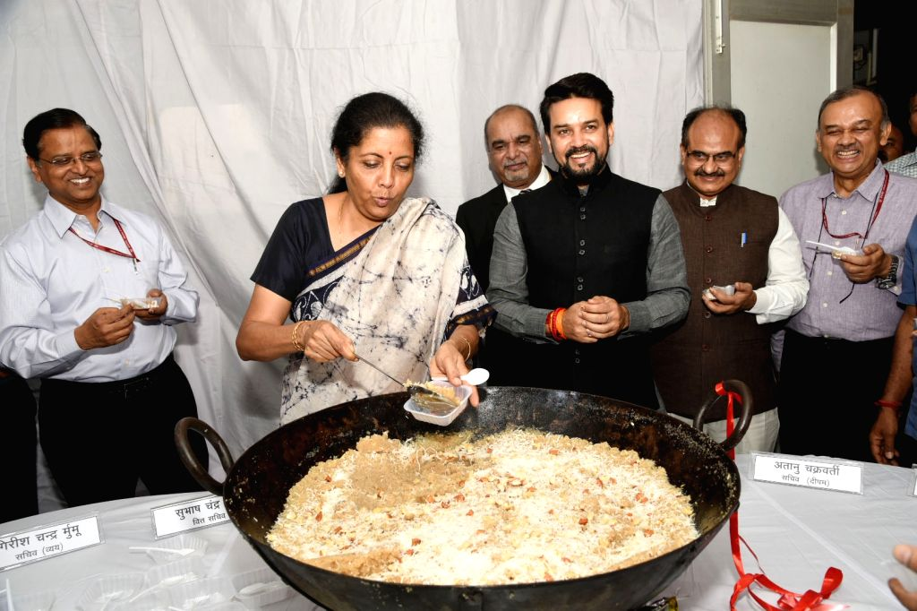 Patna: Union Finance and Corporate Affairs Minister Nirmala Sitharaman at the Halwa ceremony to mark the commencement of Budget printing process for Union Budget 2019-20, in New Delhi on June 22, 2019. Also seen Union MoS Finance and Corporate Affair - Nirmala Sitharaman