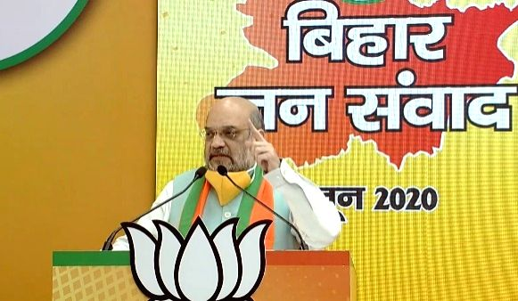 Patna: Union Home Minister and BJP leader Amit Shah addresses the people of Bihar through Bihar Jan Samvad -  the first virtual rally, on June 7, 2020. (Photo: IANS) - Amit Shah