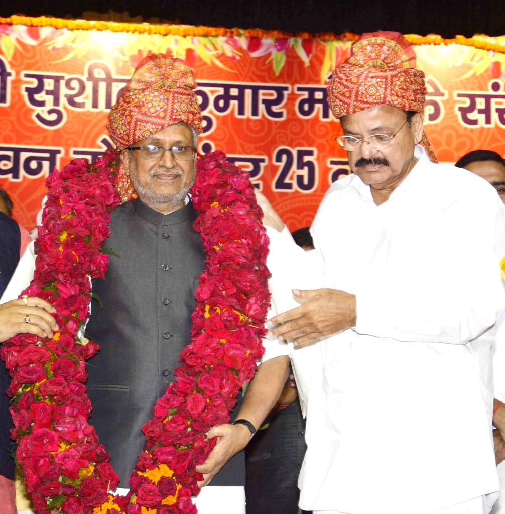 Union Minister for Urban Development, Housing and Urban Poverty Alleviation and Parliamentary Affairs M. Venkaiah Naidu felicitates BJP leader Sushil Kumar Modi during a party programme in ... - M. Venkaiah Naidu and Sushil Kumar Modi