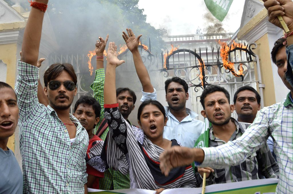 Patna University students affiliated to `Chatra Sangram` demonstrate to press for students elections in the university in Patna on Aug 5, 2014.