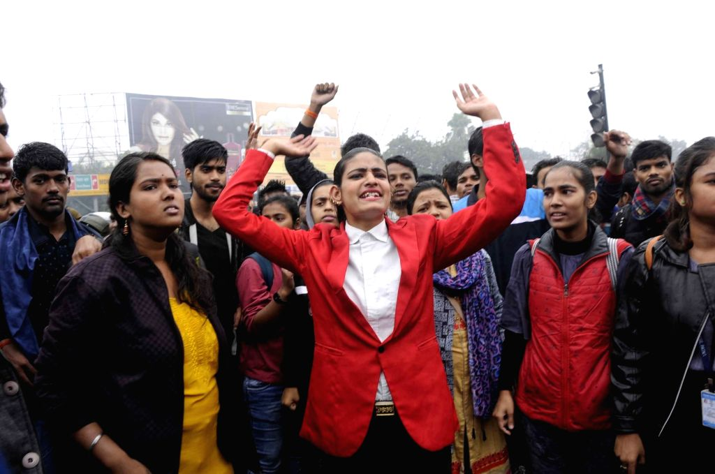 Patna University students stage a demonstration against the gang rape of a college student, in Patna on Dec 13, 2019.
