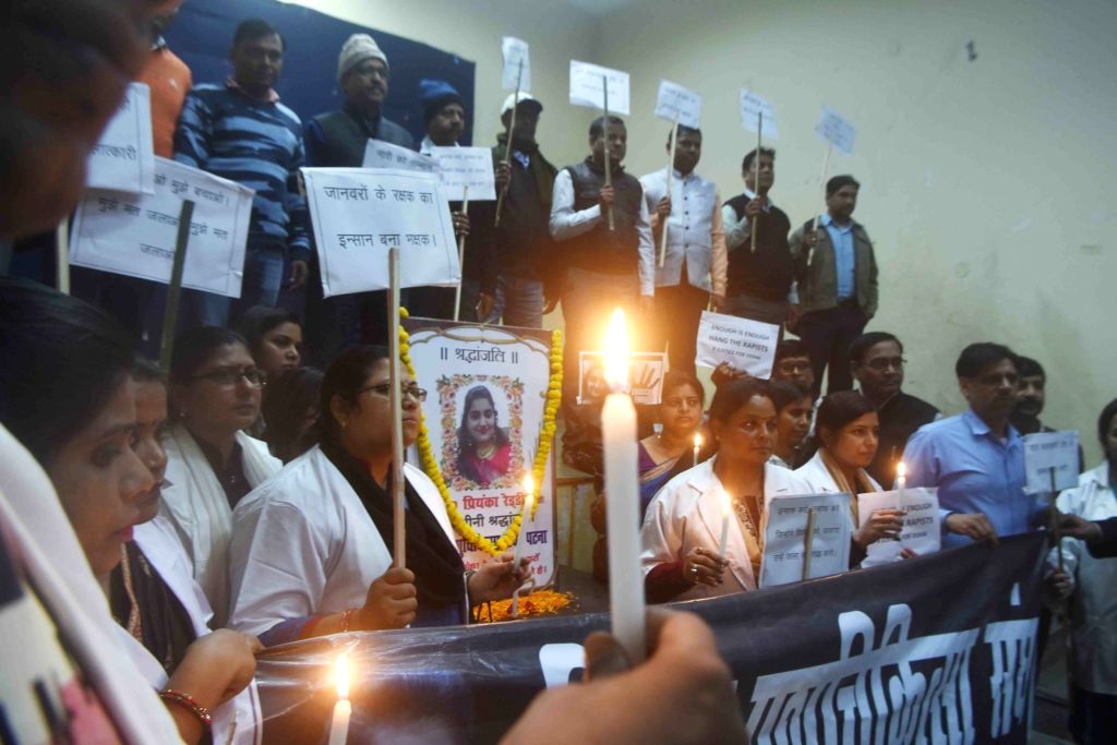 Patna: Veterinary doctors take out a candlelight vigil to protest against the gruesome gang rape and murder of a veterinary doctor in Hyderabad; demanding death penalty for the rapists, in Patna on Dec 4, 2019. (Photo: IANS)