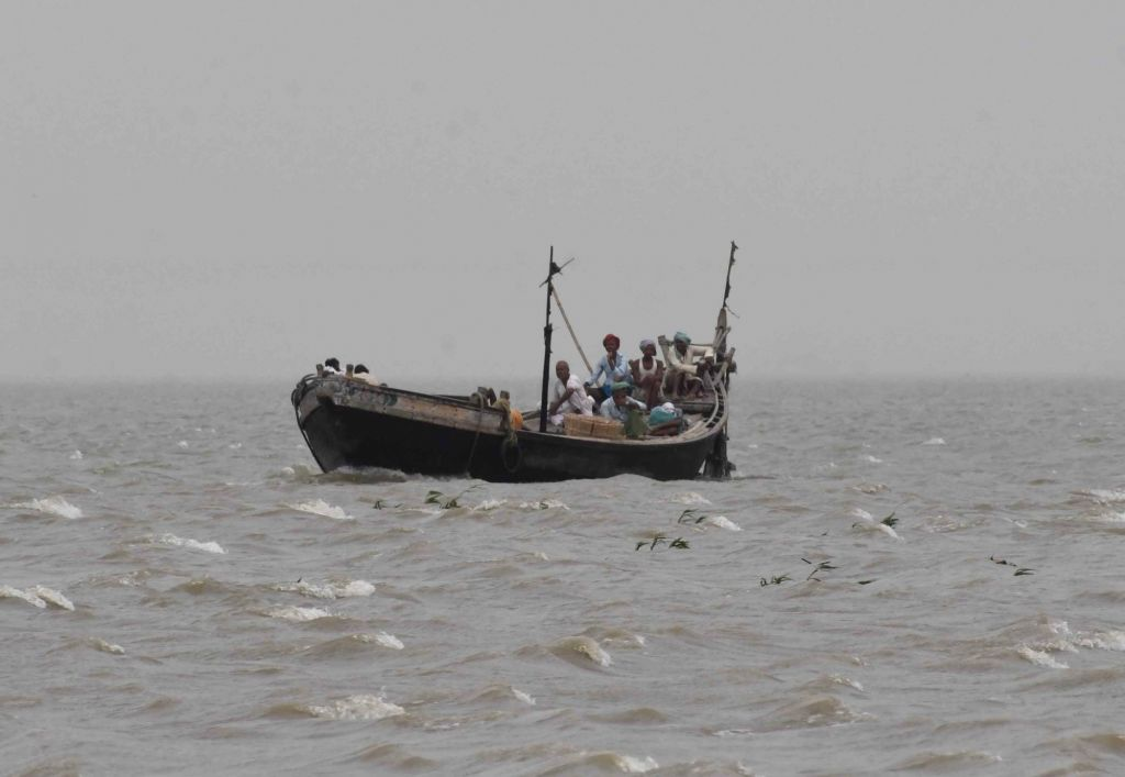 Patna: Villagers being ferried to the banks of Ganga river on a boat during a dust storm at Kala Diara village in Patna, on May 3, 2019. Bihar is witnessing weather changes due to the impact of Cyclonic storm Fani. (Photo: IANS)