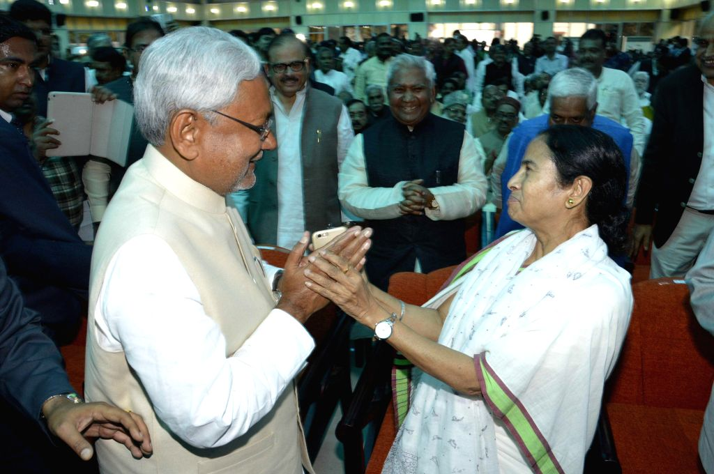 West Bengal Chief Minister Mamata Banerjee congratulates Nitish Kumar during his swearing-in ceremony as the chief minister of Bihar at Raj Bhavan in Patna on Feb 22, 2015.