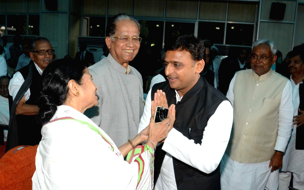 West Bengal Chief Minister Mamata Banerjee, Uttar Pradesh Chief Minister Akhilesh Yadav and Assam Chief Minister Tarun Gogoi during JD(U) leader Nitish Kumar's swearing-in ceremony as the ...