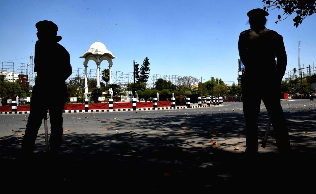 Patna: Women police personnel stand guard as they keep an eye on curfew violaters at Patna's Kargil Chowk during the 21-day nationwide lockdown (that entered the 10th day) imposed as a precautionary measure to contain the spread of coronavirus, on Ap