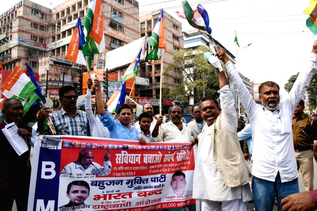 "Patna: Workers of opposition parties participate in a march organised on ""Bharat Bandh"" in Patna on March 5, 2019. (Photo: IANS)"