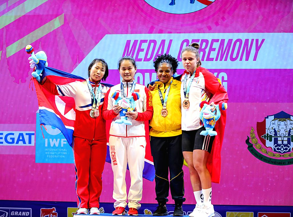 PATTAYA, Sept. 23, 2019 - Deng Wei (2nd L) of China poses for group photo with other medal winners after the women's weightlifting 64kg event at the 2019 World Weightlifting Championships held at ...