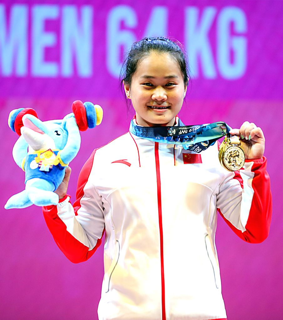 PATTAYA, Sept. 23, 2019 - Deng Wei of China shows her gold medals after the women's weightlifting 64kg event at the 2019 World Weightlifting Championships held at Pattaya, Thailand, Sept. 22, 2019.