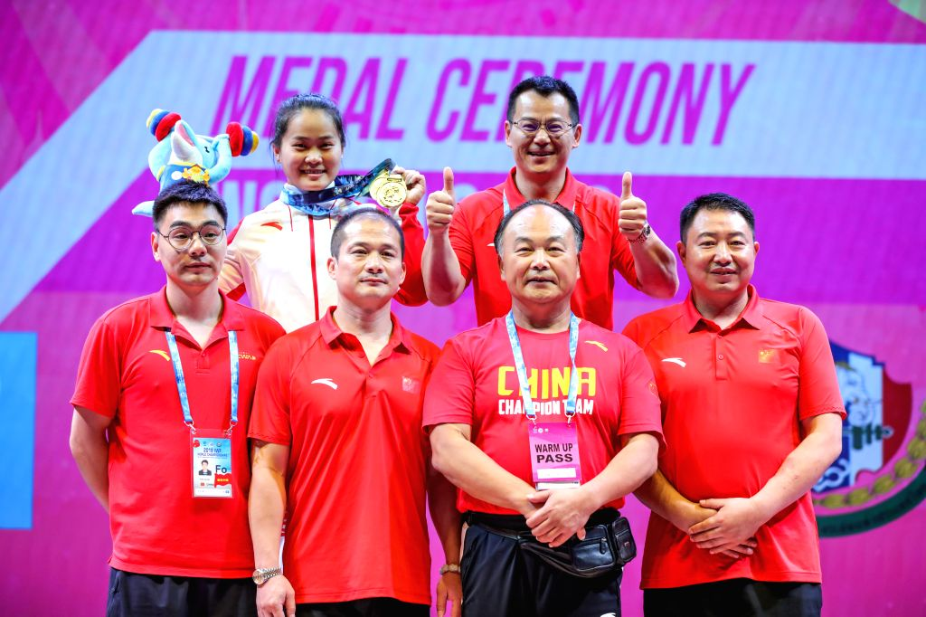 PATTAYA, Sept. 23, 2019 - Deng Wei (Top L) of China poses for group photo with her coaches after the women's weightlifting 64kg event at the 2019 World Weightlifting Championships held at Pattaya, ...