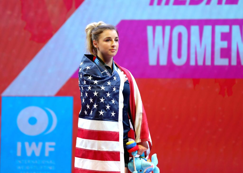 PATTAYA, Sept. 23, 2019 - Katherine Nye of the United States sings national anthem at the victory ceremony after the women's weightlifting 71kg event at the 2019 World Weightlifting Championships in ...