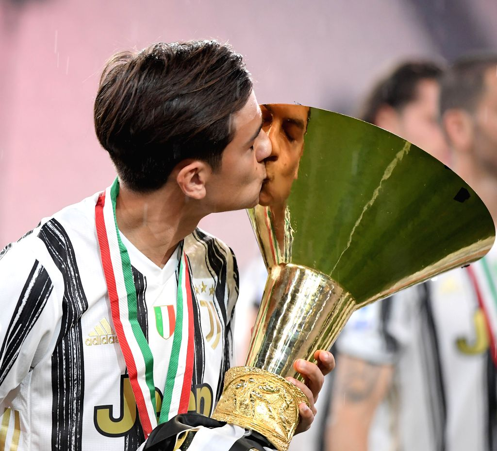 Paulo Dybala of FC Juventus kisses the trophy at the end of the Serie A football match between FC Juventus and Roma in Turin, Italy, Aug 1, 2020.