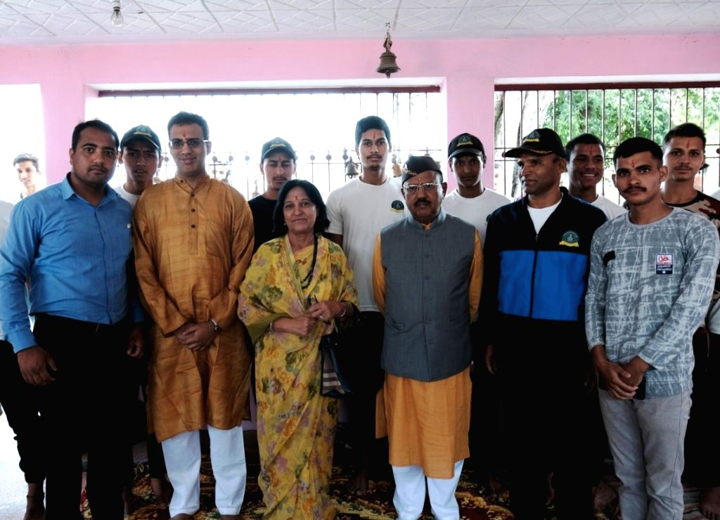 Pauri: National Security Advisor Ajit Doval with his family during a pooja at his native village Ghidi, in Pauri district on June 22, 2019. (Photo: IANS)