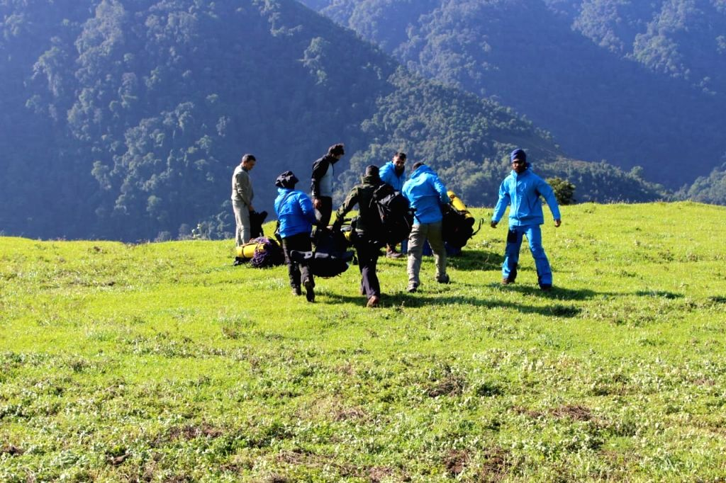Payum: Mountaineers move towards the crash site of IAF's AN-32 aircraft at Payum in Arunachal Pradesh on June 12, 2019. A total of 15 mountaineers from IAF, Army and civilians were inducted successfully by Mi 17 near the crash site. (Photo: IANS)