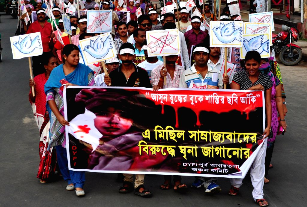 Peace activists participate in a rally organised on the 69th anniversary of the US atomic bombings on the Japanese city of Hiroshima, in Agartala on Aug 6, 2014.
