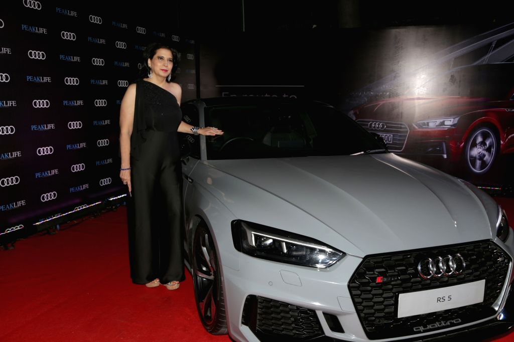 Peaklife magazine Chief Editor and Publisher Parineeta Sethi poses with the Audi RS 5 Coupe at Audi Peaklife Fashion Capsule in New Delhi, on April 5, 2019.