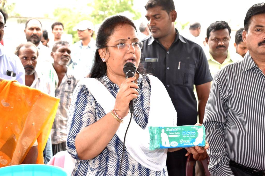 Peddapalli (Telangana): Collector is displaying sanitary pad 'Sabala' packet at a meeting