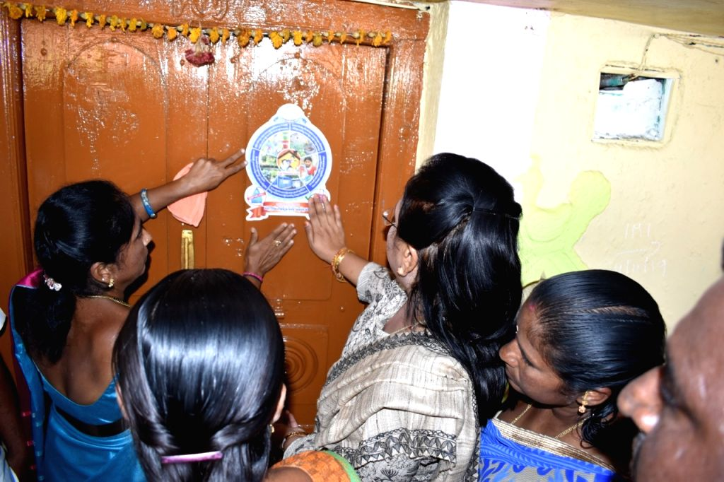 Peddapalli (Telangana): Collector pasting sticker on a house, which achieved all five goals of sanitation
