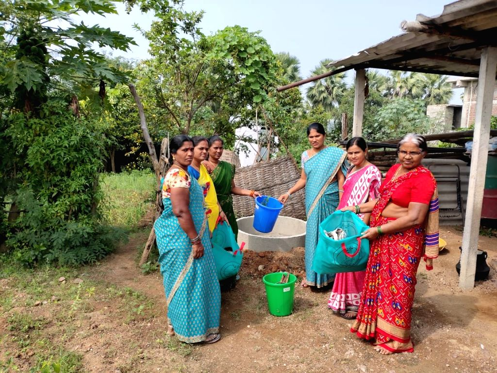 Peddapalli (Telangana): women in a village showing dustbin and bags to segregate waste