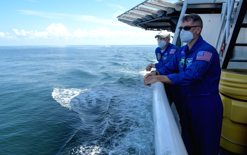Pensacola (U.S.), Aug. 2, 2020 NASA Chief Astronaut Pat Forrester (L) and NASA astronaut and Crew Recovery Chief Shane Kimbrough onboard the SpaceX recovery vessel GO Navigator, prepare ...