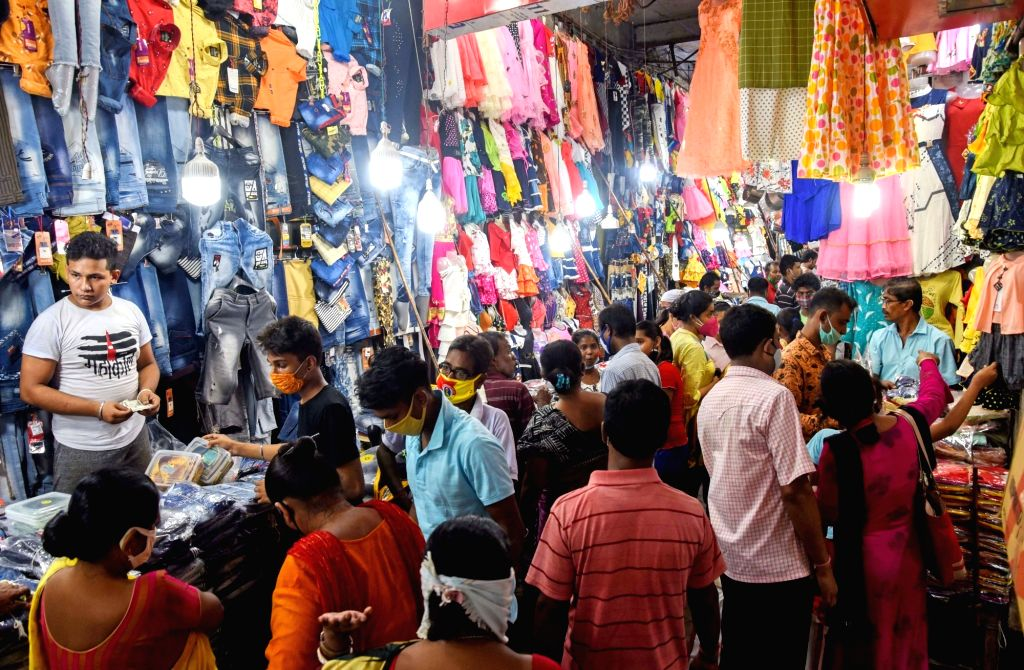 People are busy shopping at the market ahead of Durga Puja festival in Kolkata on October 10, 2020.