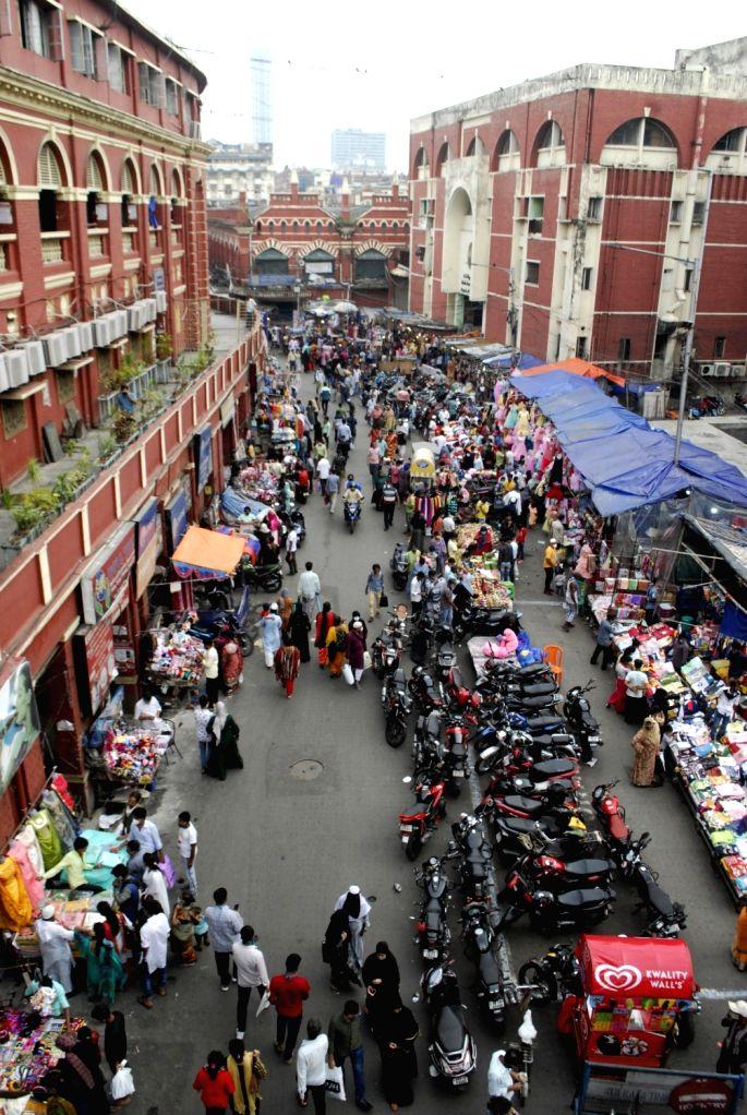 People are marketing at New Market ahead Eid al-Fitr festival in Kolkata on May 4, 2021.