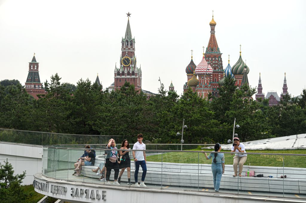 People are seen at a park in Moscow, Russia, on July 8, 2020. Russia registered 6,562 new COVID-19 cases in the past 24 hours, taking its total to 700,792, the ...